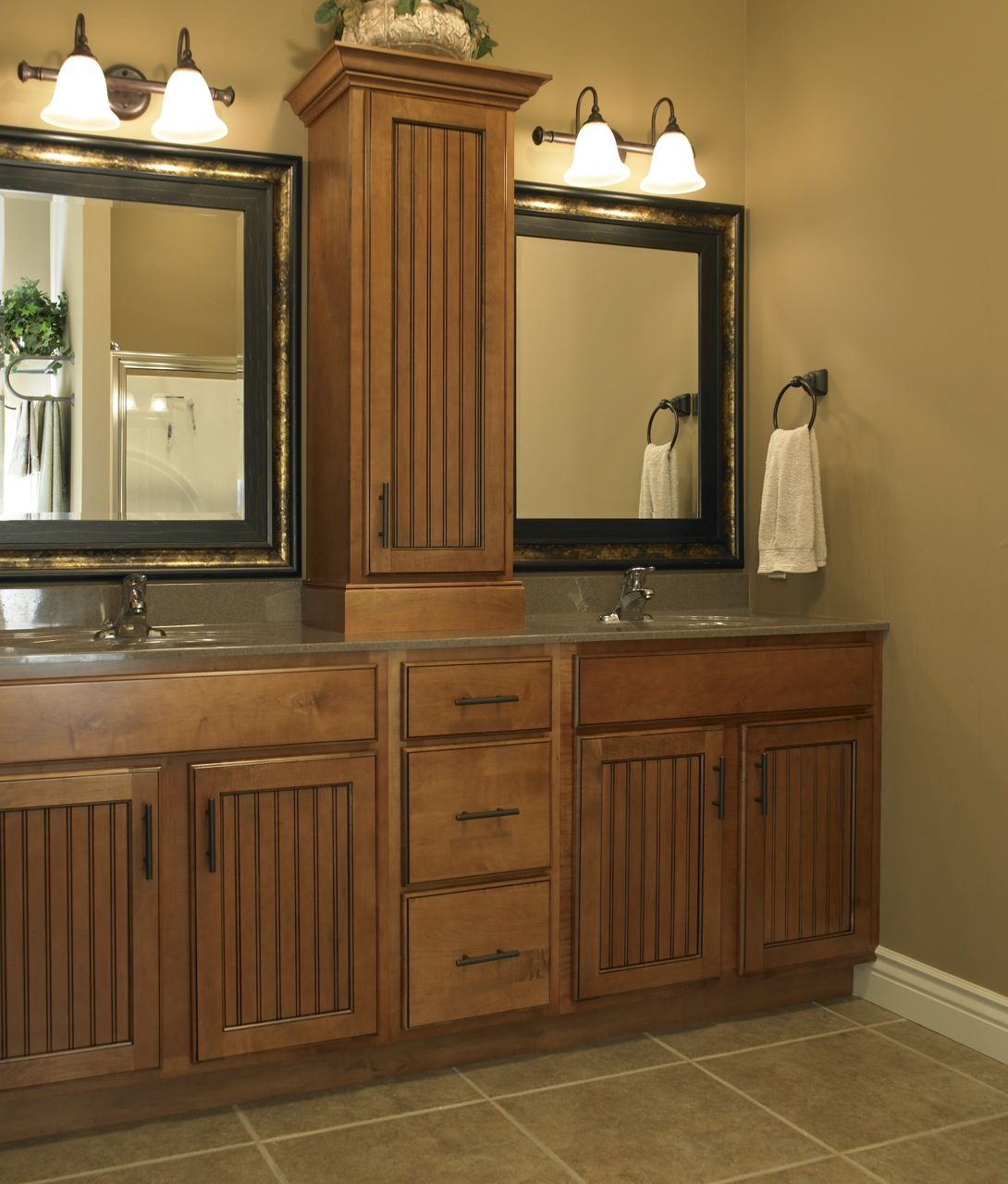 Double Vanity With Lamp Lighting Above The Mirror Baths