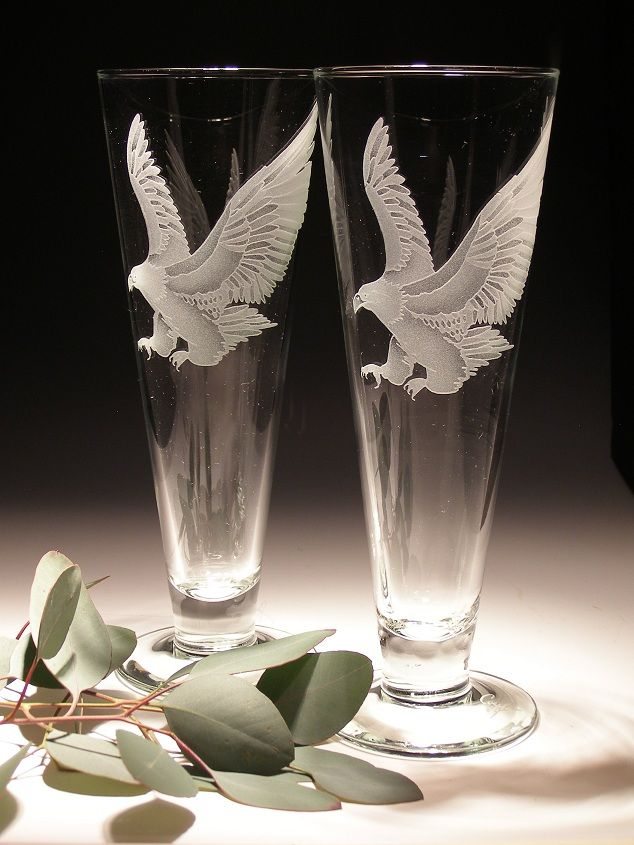 Master crystal carver and artist Lorraine Coyle has created this elegant #Eagle Pilsner Glass set of two. http://www.wildlifewonders.com/eaglepilsnerglass.html