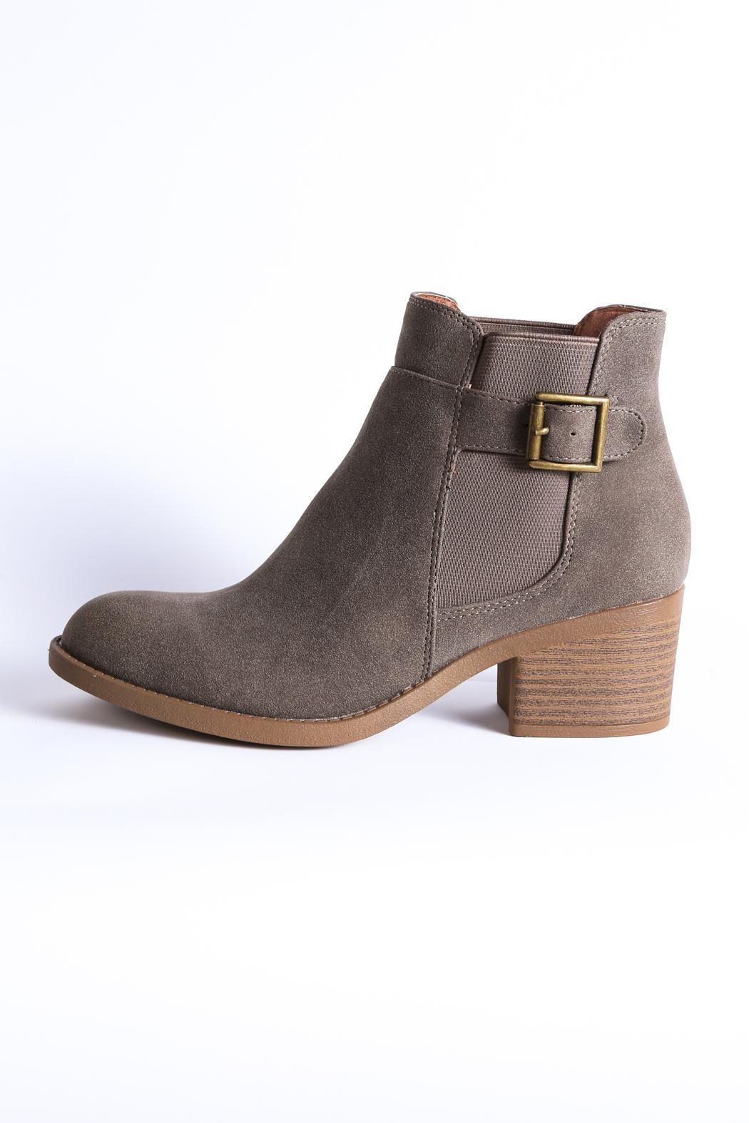 "Featuring a nubuck leather look and faux wood heel, this beauty will be a staple in your wardrobe. Wear with dresses, skinnies, skirts, you name it! Toe: Round. Style: Chelsea boot. Closure: Slip on. Side goring. Nubuck look. Wood look heel. Buckle detail. Loose without socks; just right with socks!    Heel height: 2.25"" heel height. 5.75"" shaft height.    Philly Ankle Boot by Qupid. Shoes - Booties - Heeled Georgia"