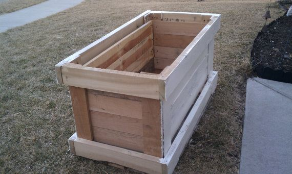 pallet flower planter by WaltsUpcycledWood on Etsy, $120.00Good use for a pallet.