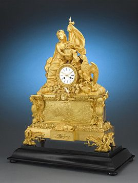 Powerful symbolism and sophisticated design inform this rare Napoleonic clock ~ M.S. Rau Antiques