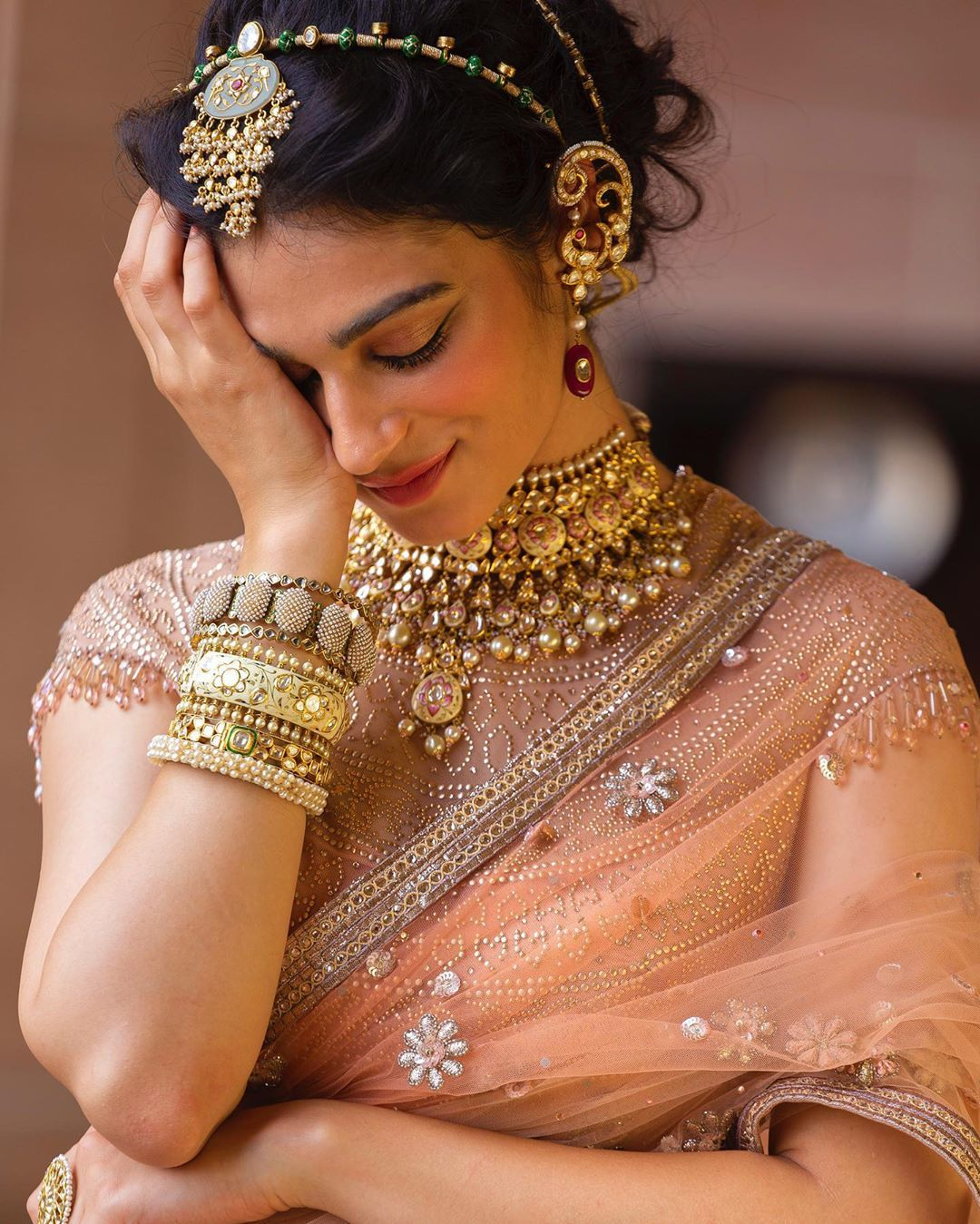 Photo of Peach wedding saree Bridal jewellery
