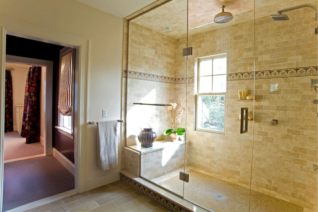 Master bathroom double walk in glass shower with window rain shower head stone tile work Tile in master bedroom closet