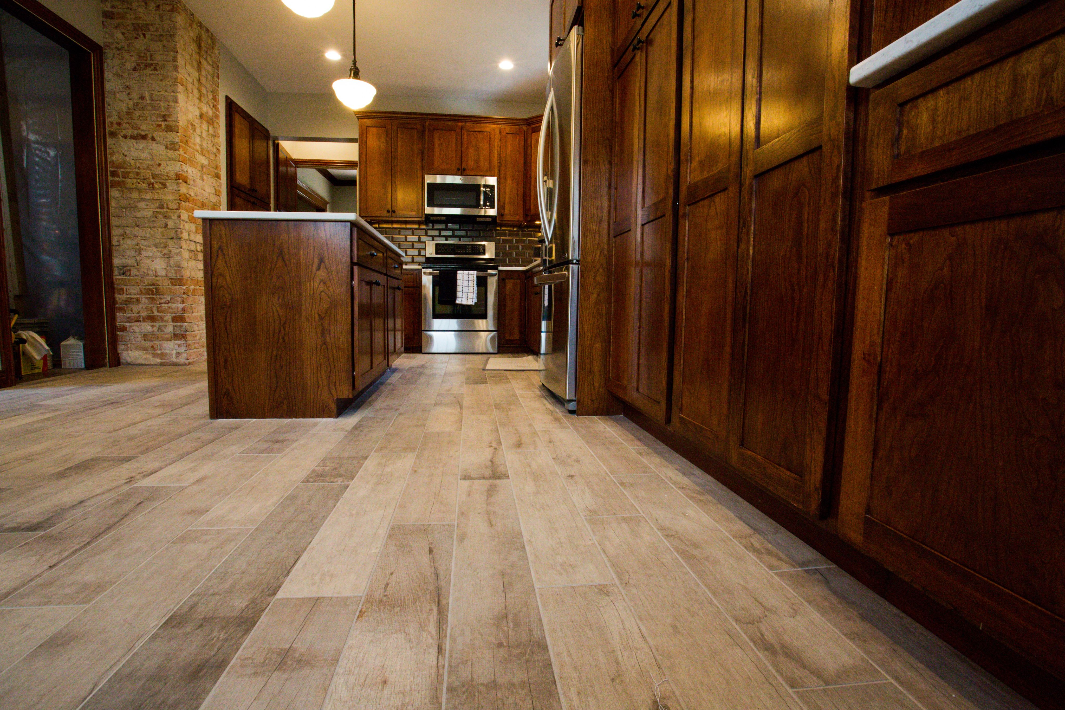 wood look tile and dark cherry cabinets