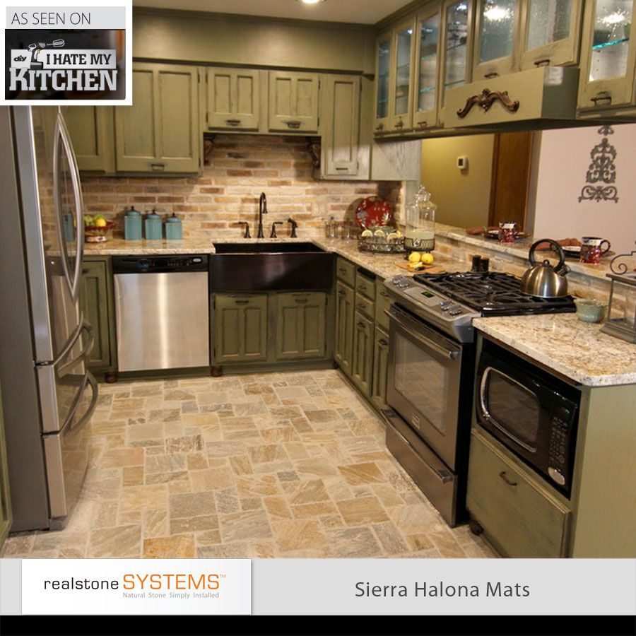 Stone floors and a brick backsplash with olive green wood for Kitchen units made of bricks