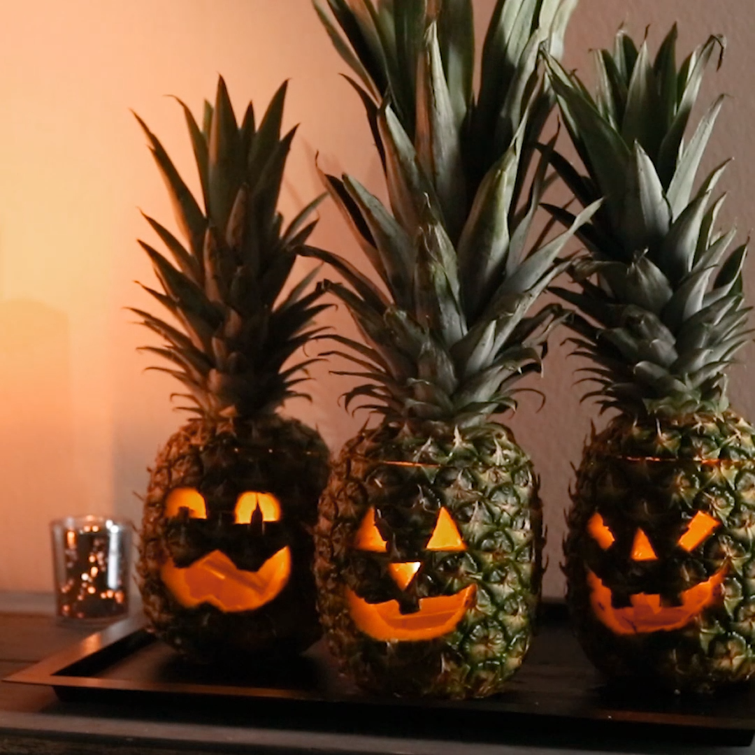 No matter how you carve them, these pineapple jack-o'-lanterns will make a big statement—we'll show you how to carve one in three easy steps and in less than 30 minutes! #carvedpineappleforhalloween #jackolanternpineapple #carvedpineapple #halloween #bhg