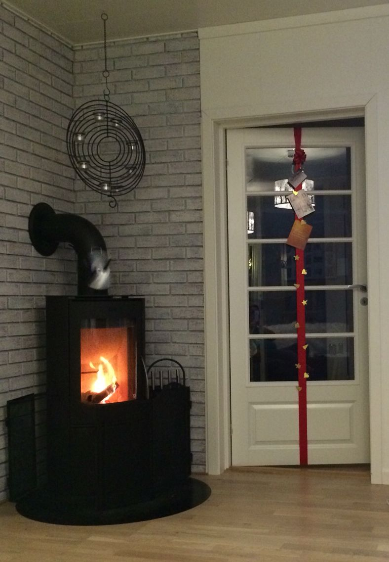Christmas card display. Wide ribbon on door with some decorative pegs.