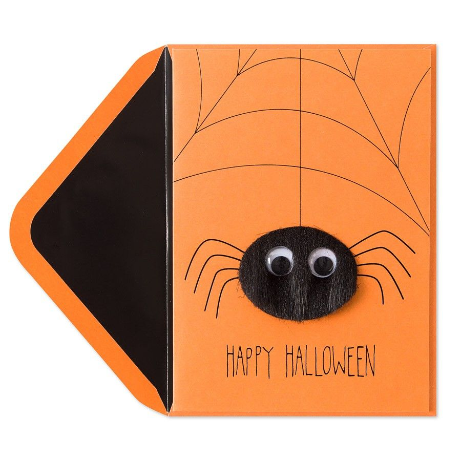 A fuzzy spider with googley eyes comes down from his web on this spooky orange…