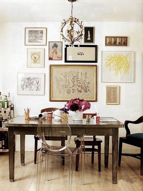 Eclectic Home Office. Home Decor And Interior Decorating Ideas. Antique  Pictures And Table With Very Modern Lucite Chair.