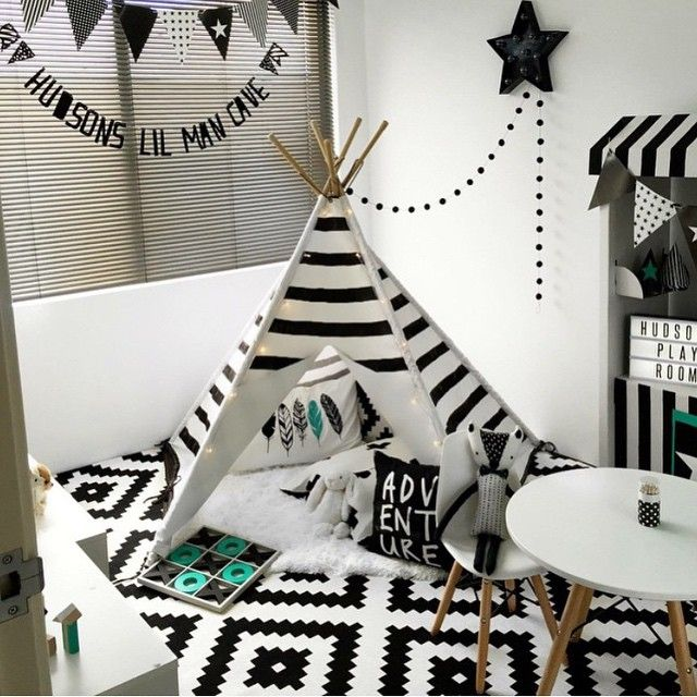 A cool monochrome playroom featuring a Mocka Black Stripe Teepee styled by Alicia Adams.