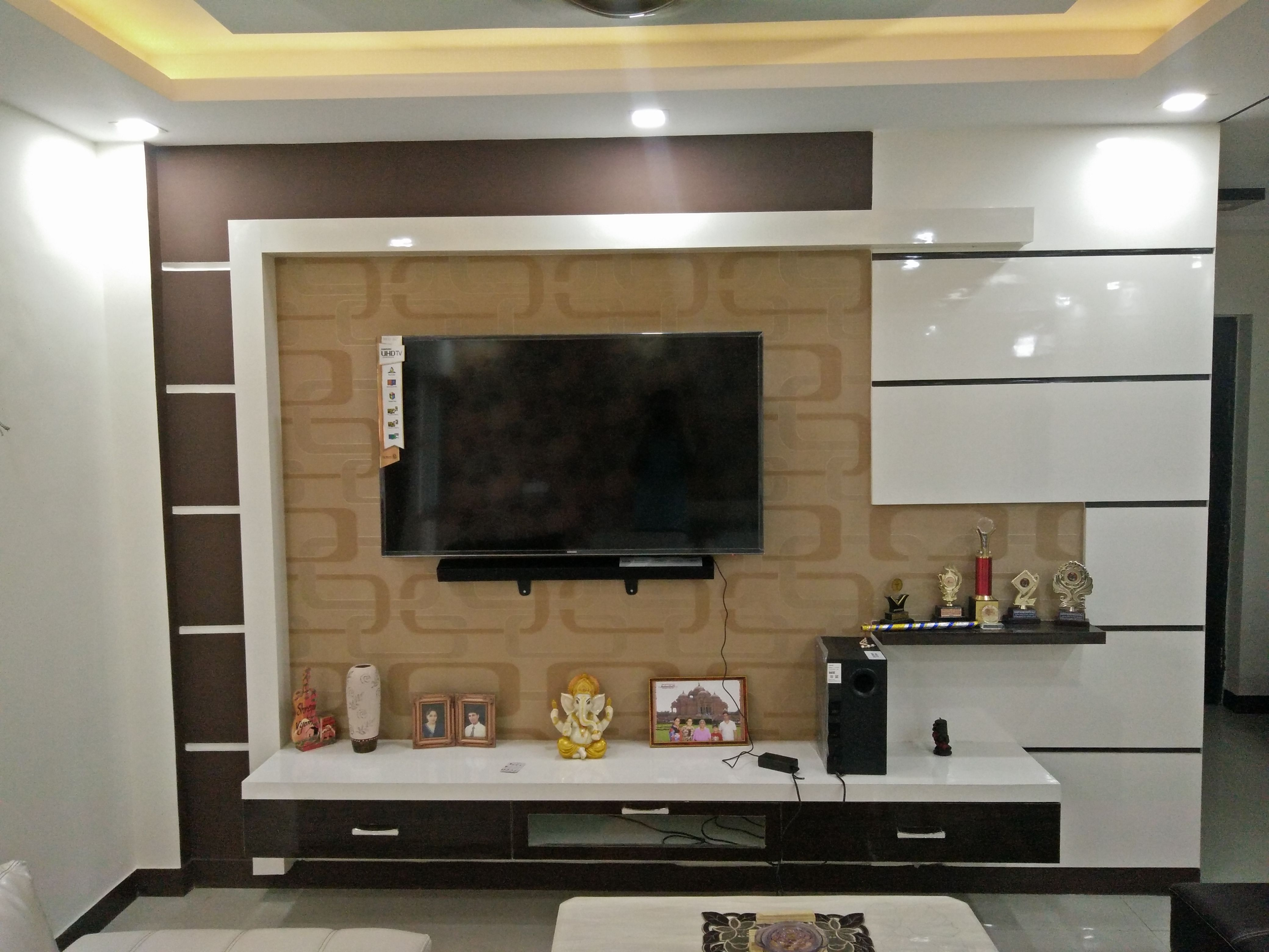 Modern stylish elegant brown white tv unit design by for Interior cupboard designs for hall