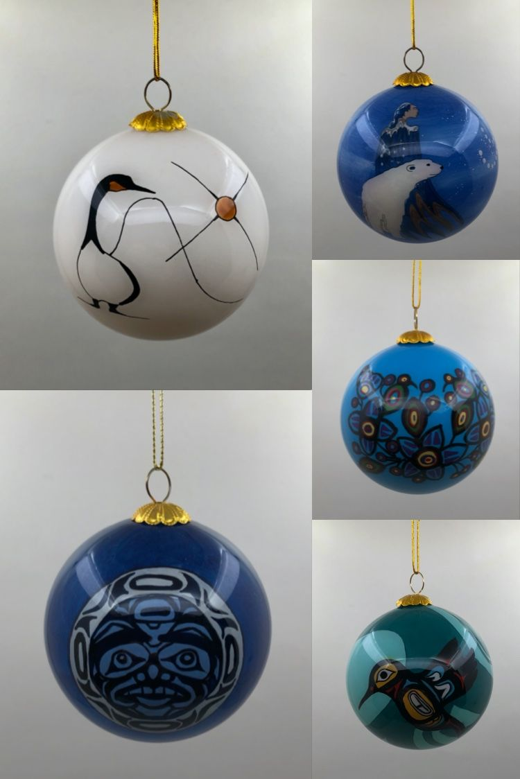 Glass Christmas ornaments featuring designs by various