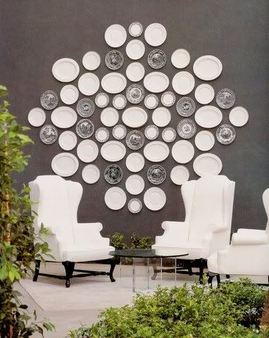 The emphasis in this room is the artwork of plates on the wall. It catches the eye because it contrasts with the wall color and itu0027s a big decoration. & 20 Best Budget Decorating Tips | Budgeting Decorating and Wall colors