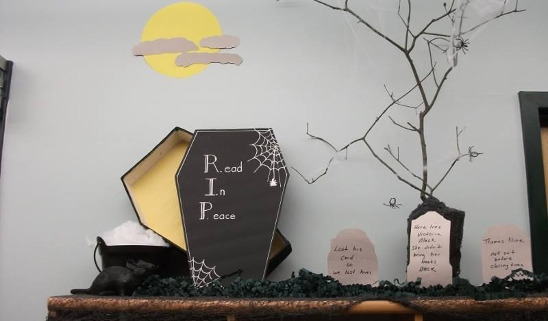 Library Halloween Display! R.I.P.: Read in Peace, We made our own graveyard and added in some library humor.