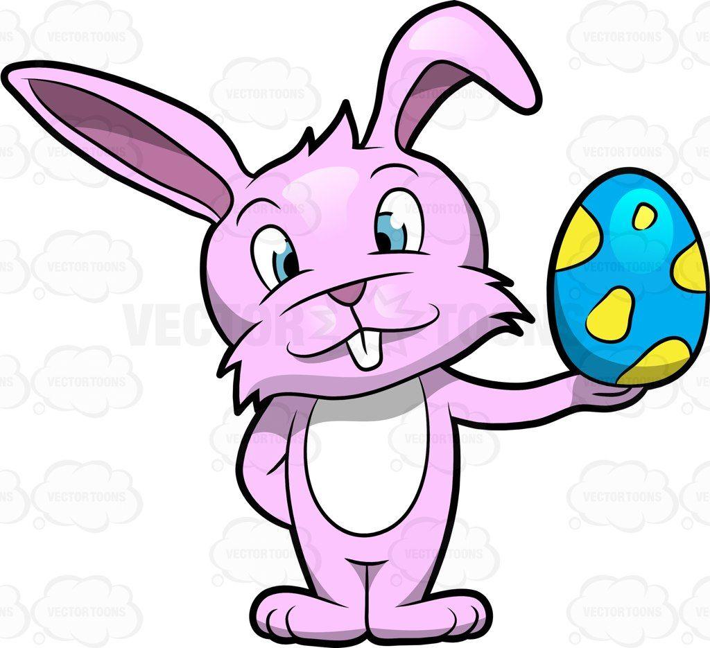 A Cute Bunny Holding Up An Easter Egg Fabrics