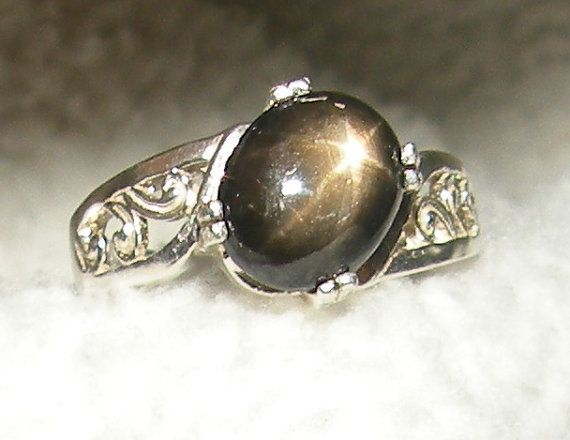 Black Star Sapphire Ring By Candiesthings On Etsy I Think I Really Like This One Star Sapphire Ring Royal Engagement Rings Star Sapphire