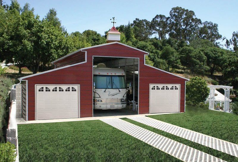 Steel building red rv barn in farm red steel building for Rv storage buildings with living quarters