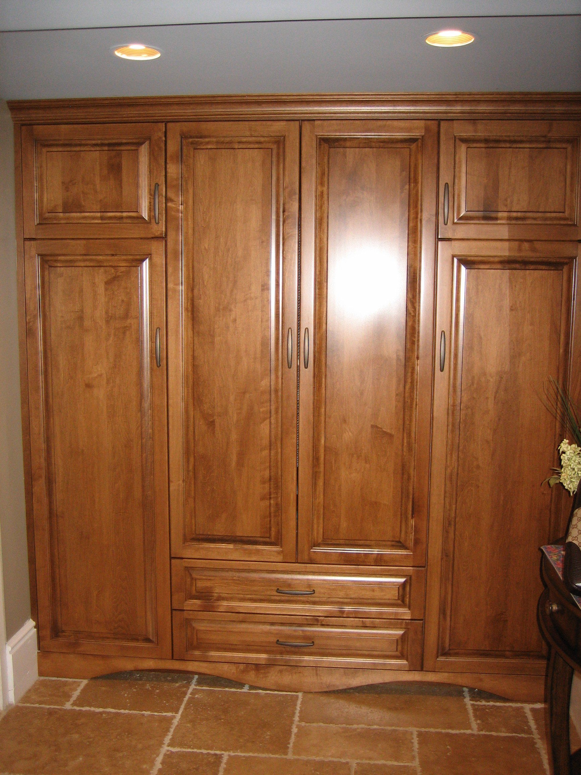 Foyer Storage : Entry way closet for storage of coats and shoes. foyer