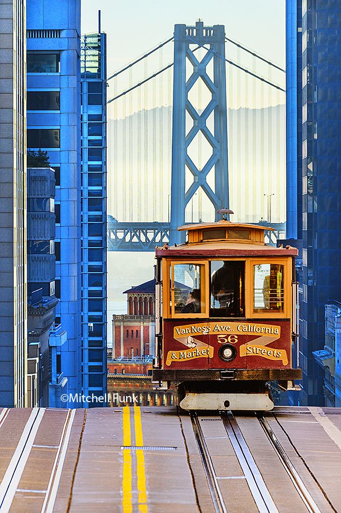 Cable Car On California Street With Bay Bridge In The Background