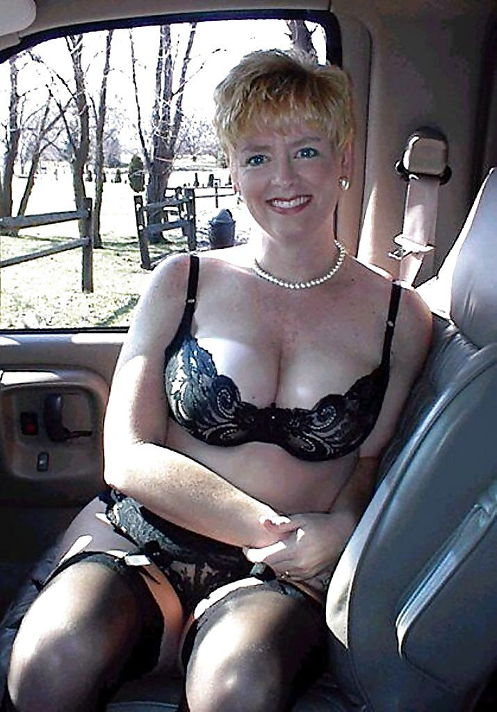Mature leggy lady in car