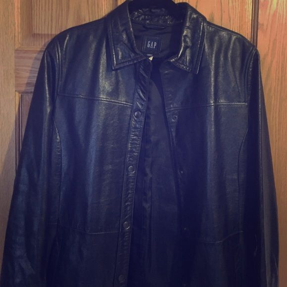 Gap vintage genuine leather trench coat Very chic and sophisticated black long genuine Gap leather trench coat. Size L. The waist strap is not the original strap but matches very well. Rarely used and in great condition! GAP Jackets & Coats Trench Coats
