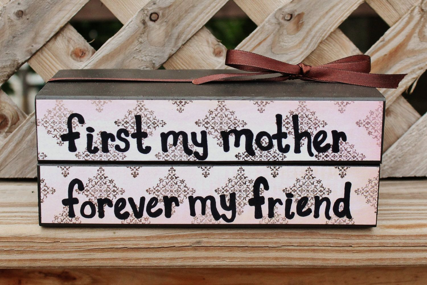 First my mother forever my friend stacked wooden blocks