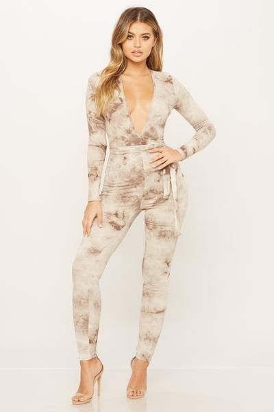 fbf9b2fa94e Tie dye jumpsuit featuring a deep v neck. Deep v neck Long sleeves Tie  around waist tie Pants 95% Rayon