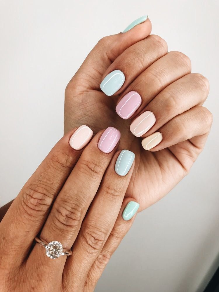Multi,colour pastel nails.