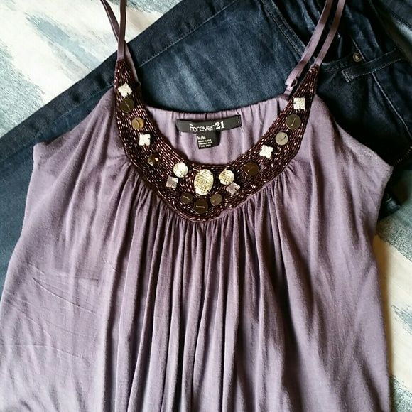 Purple jeweled tank Purple tank with adjustable spaghetti straps and jeweled neckline. Material in good condition but shows some signs of wear. Forever 21 Tops Tank Tops