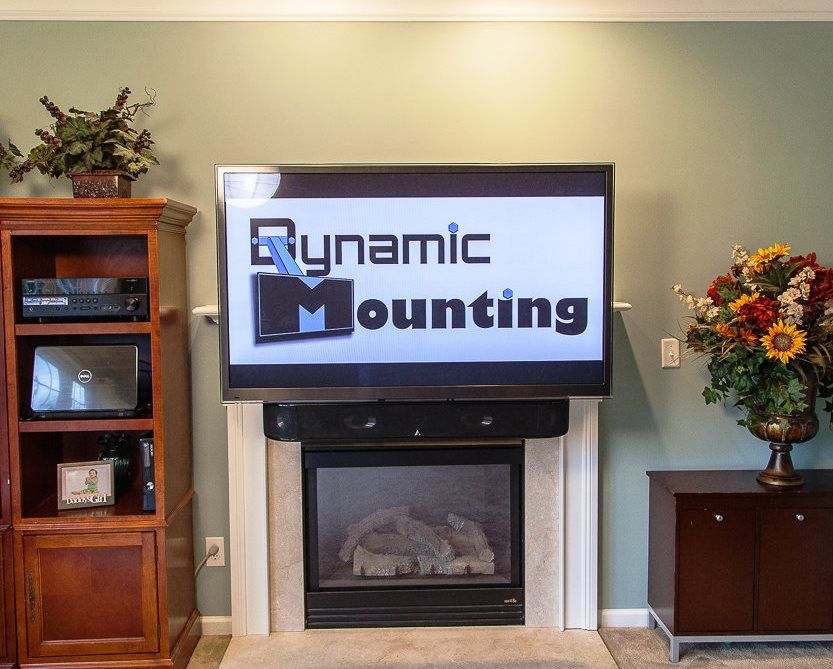 Drop down tv mounts latest how to make a drop down tv for Motorized tv mount over fireplace
