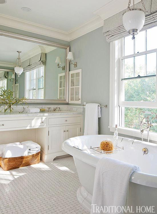 Dream master bathroom: Large open bathroom with light blue walls and white  cabinets and designer bathtub.