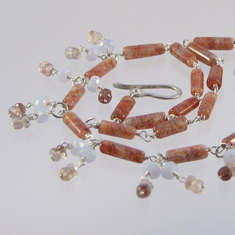 Necklace with sunstone, calcedonia, rutilquartz on fine silver.