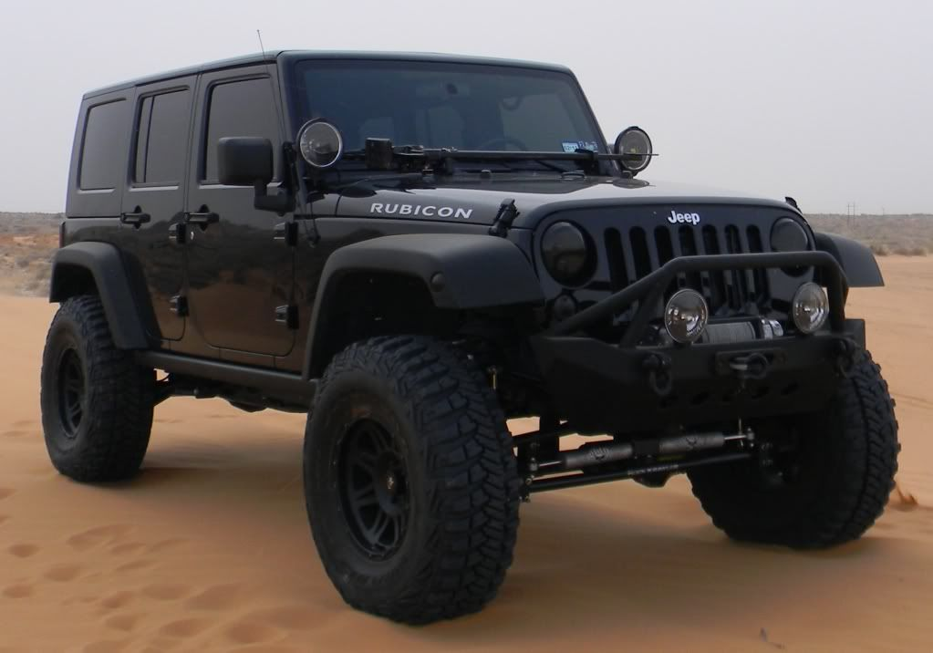 I WANT THIS MORE THAN ANYTHING. but green, not black. dark green, not that stupid 'rescue' neon green or w/e it's called. 4wd, and lifted. ohmahgawd...wantttt