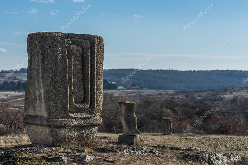 Many stone sculptures in the landscape Stock Picture