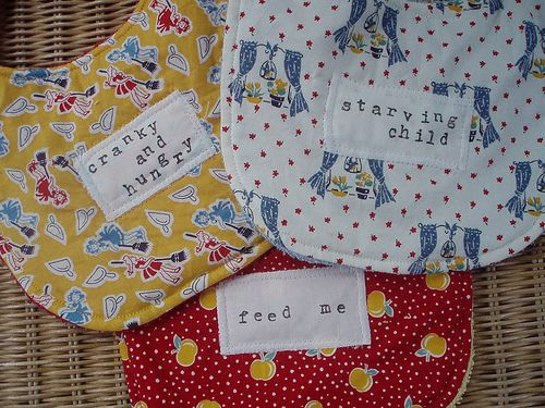 bibs, words stamped on muslin w/ permanent fabric ink, bath towels on the back