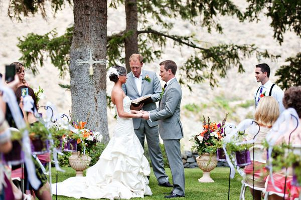 outside wedding with cross on tree and plants to each side of bride and groom...pretty