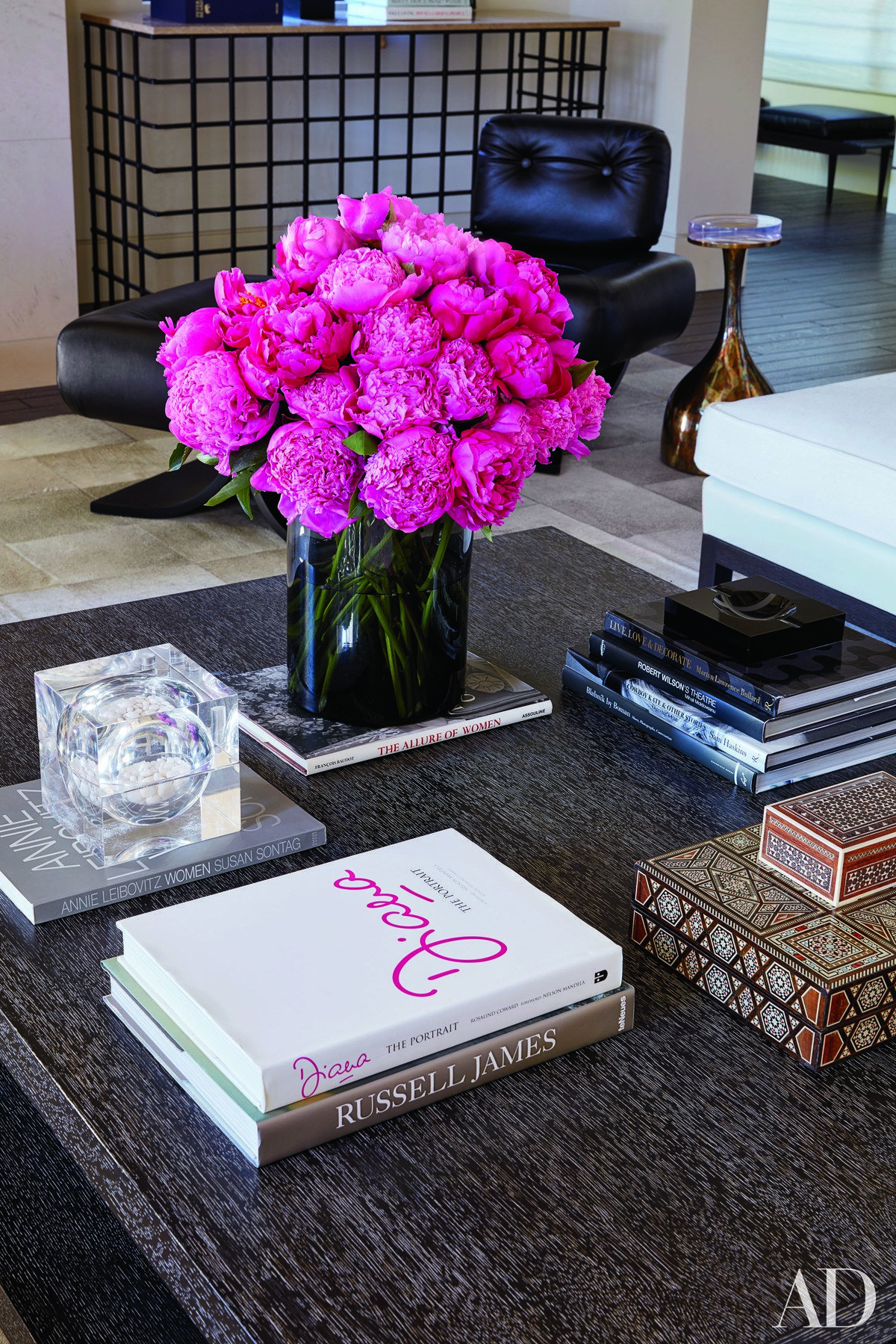 Stylish Celebrity Coffee Tables From Patrick Dempsey Chrissy Teigen And Naomi Watts Architectural Digest Center Table Decor Living Room Center Chanel Coffee Table Book [ 1799 x 1200 Pixel ]