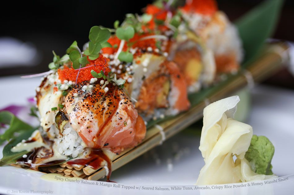Spicy Crunchy Salmon and Mango Roll Topped with Seared Salmon, Tuna, Avocado, Crispy Rice Powder and Honey Wasabi Sauce