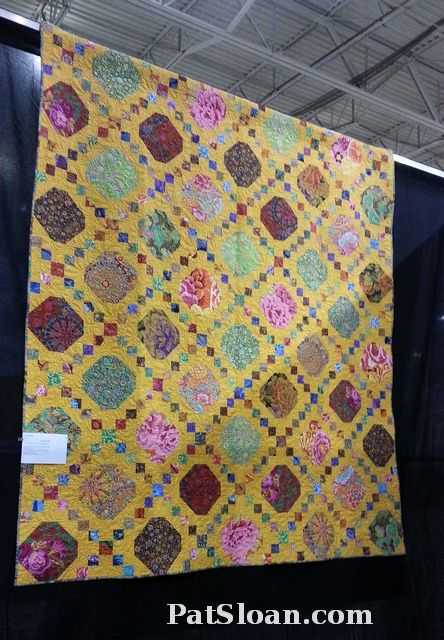 Snowball and Irish chain quilt in Kaffe Fassett fabrics, made by Sue Hickman