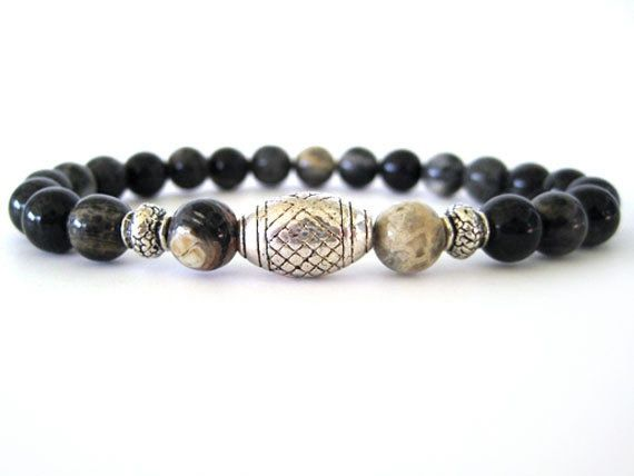 Cool men's beaded stretch bracelet featuring 8mm black silver leaf beads and pewter accent beads. A very masculine men's bracelet any man would love! Wear individually or stack with leather wraps, a watch or other Rock & Hardware men's bracelets for a more stylish option.:
