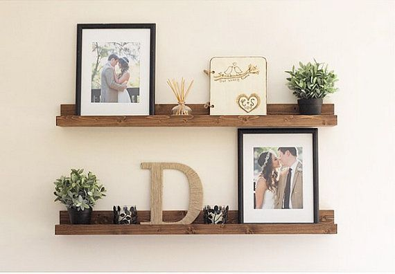 Pretty Floating Shelves With Photos And Small Plants Would Be A Great Spot For Some Succulents