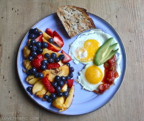 A Healthy Breakfast Food Fruit Strawberries Blueberries Eggs Eating Avocado