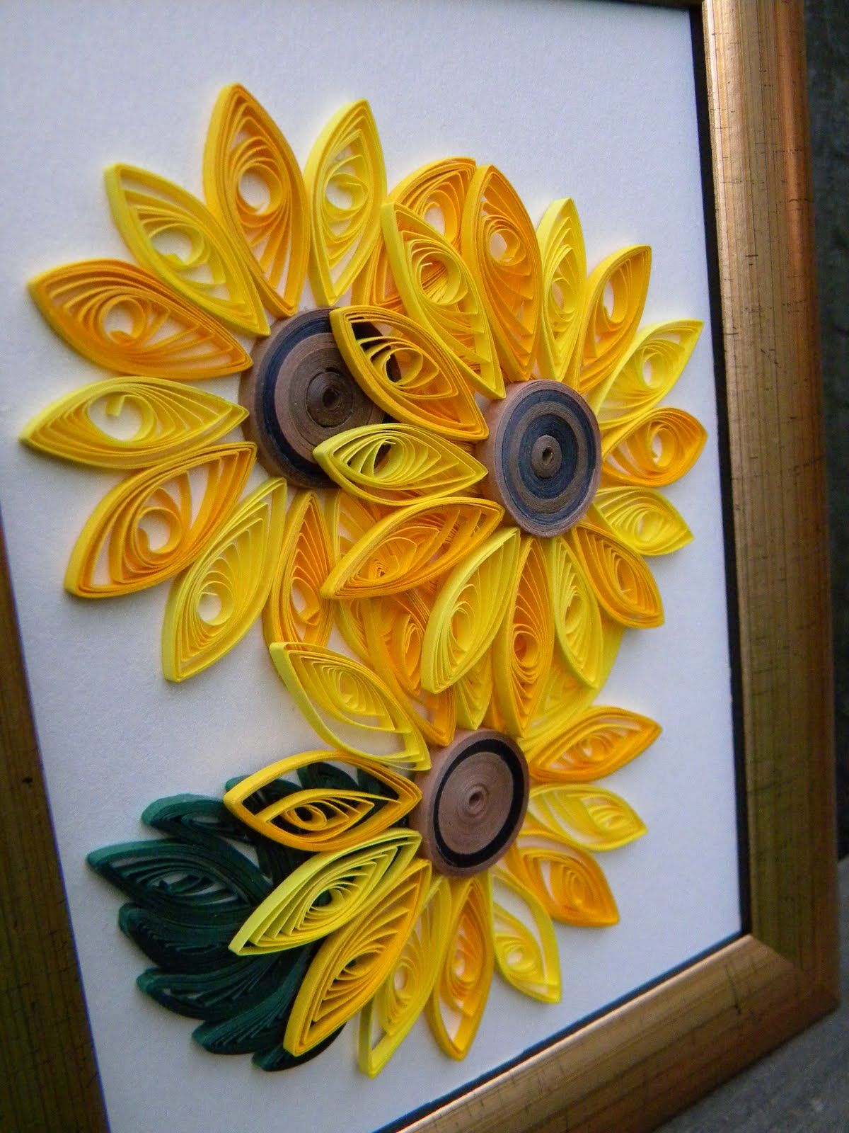 Quilled sunflowers for kids this was okay good age for Paper quilling work