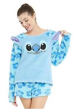 "<div>The moment you feel how soft this plush sleep set from Disney's <i>Lilo & Stitch</i> is, you'll definitely want to make it part of your Ohana. Or at least your wardrobe. The long-sleeved shirt has Stitch's face on the chest with 3D ears at the shoulders and hibiscus print sleeves with thumb holes. The plush shorts have a matching allover hibiscus print. </div><div><ul><li style=""LIST-STYLE-POSITION: outside !important; LIST-STYLE-TYPE: disc !important"">100% polyester</li><li st..."