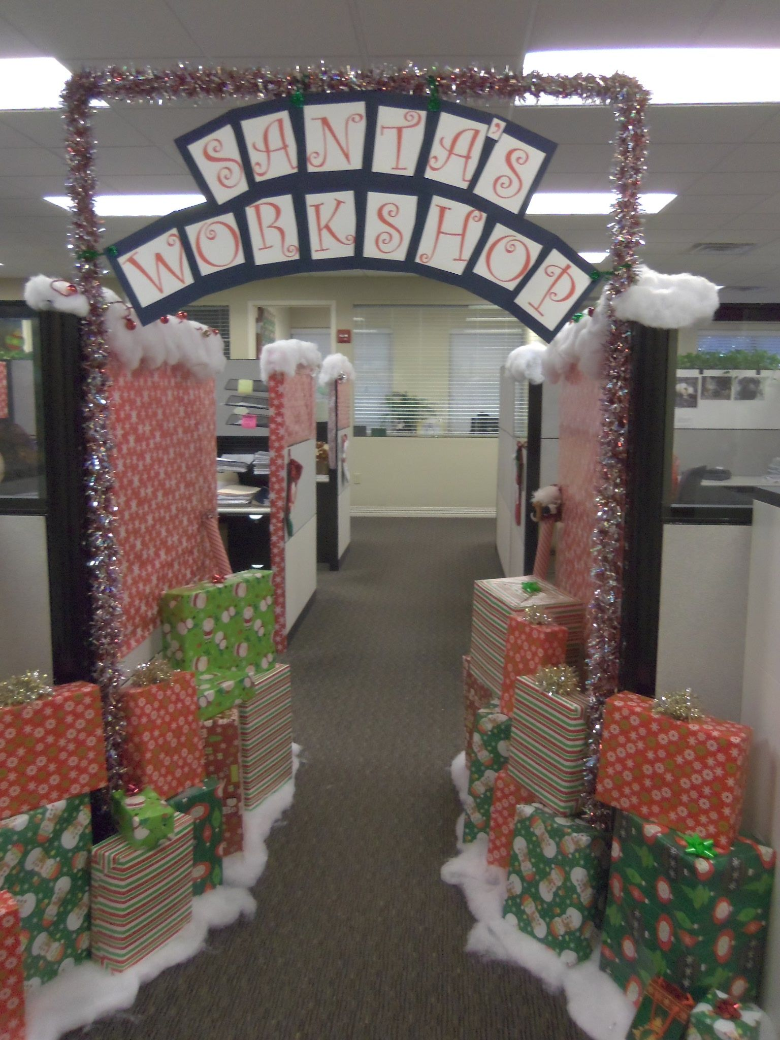 Christmas decorations can boost morale at the office. Leland ...