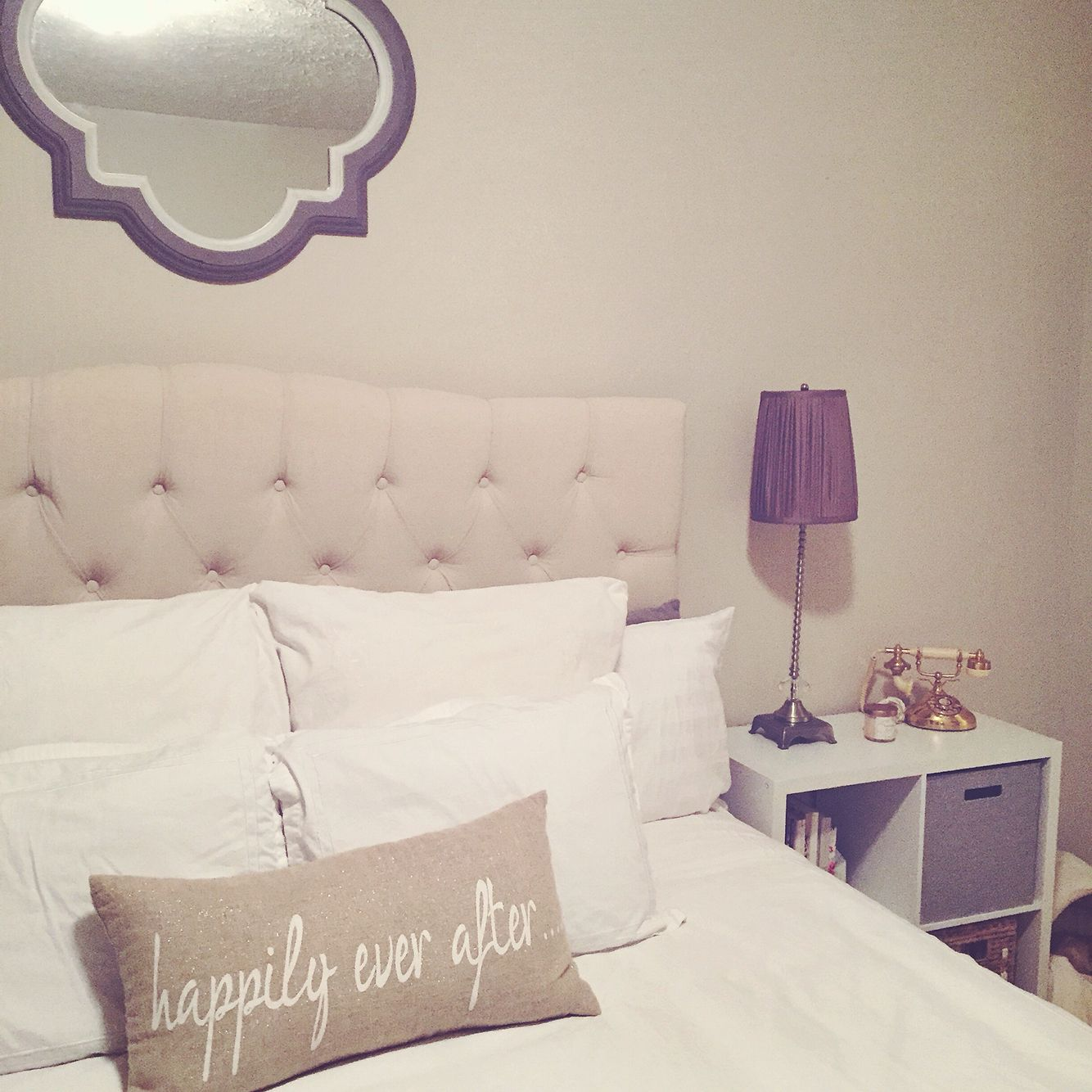 Tufted headboard, happily ever after, above the bed mirror