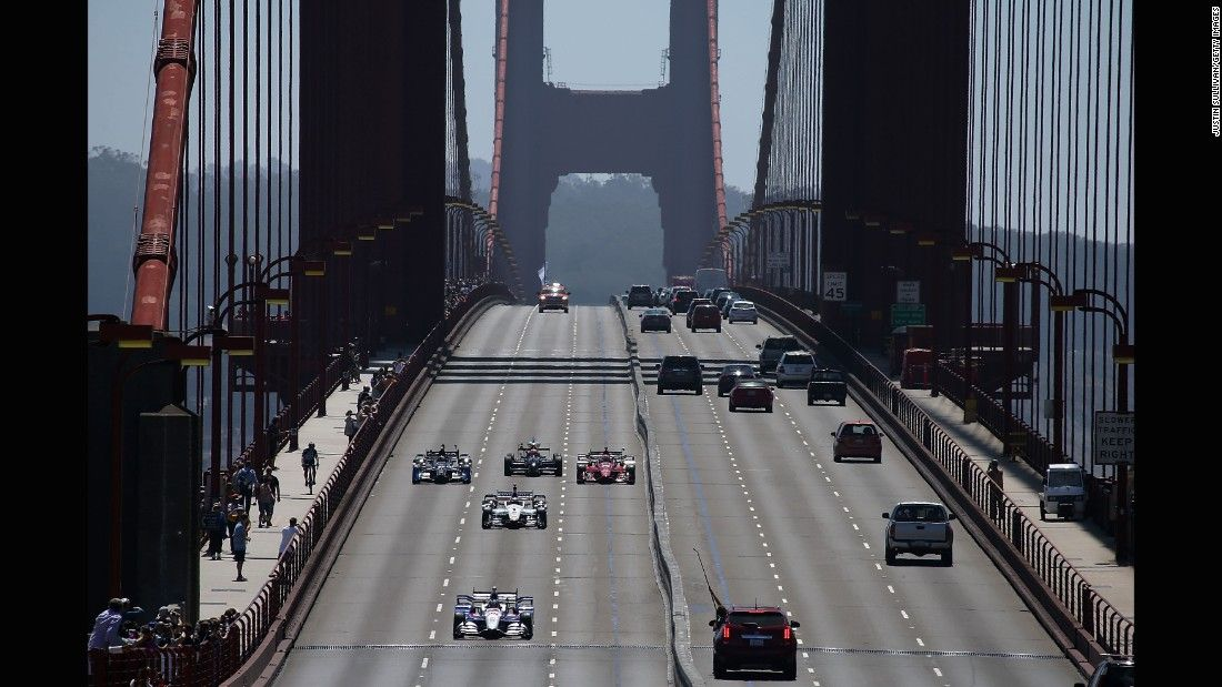Marco Andretti leads a pack of race cars over San Francisco's Golden Gate Bridge on Thursday, August 27. The crossing paid tribute to IndyCar driver Justin Wilson, who died earlier in the week from injuries he sustained on the racetrack.