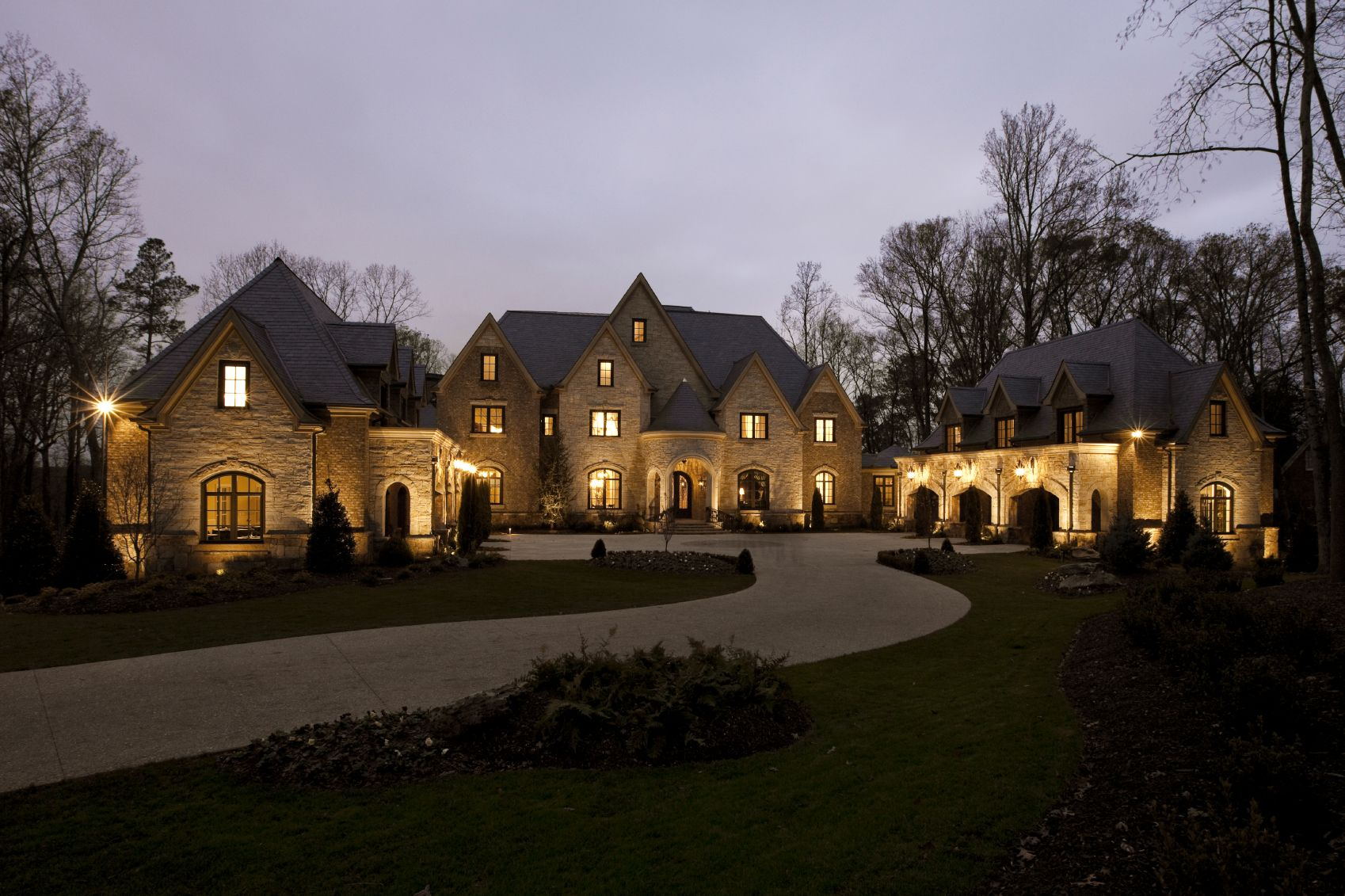 LUXURY DRIVE WAYS | Long Winding Driveway Leading Up To The Main Entrance  Of Elegant Stone .