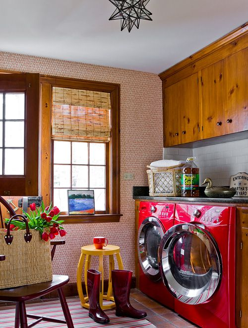 Suzie: Katie Rosenfeld Design - Eclectic laundry room with red geometric wallpaper accent wall, ...
