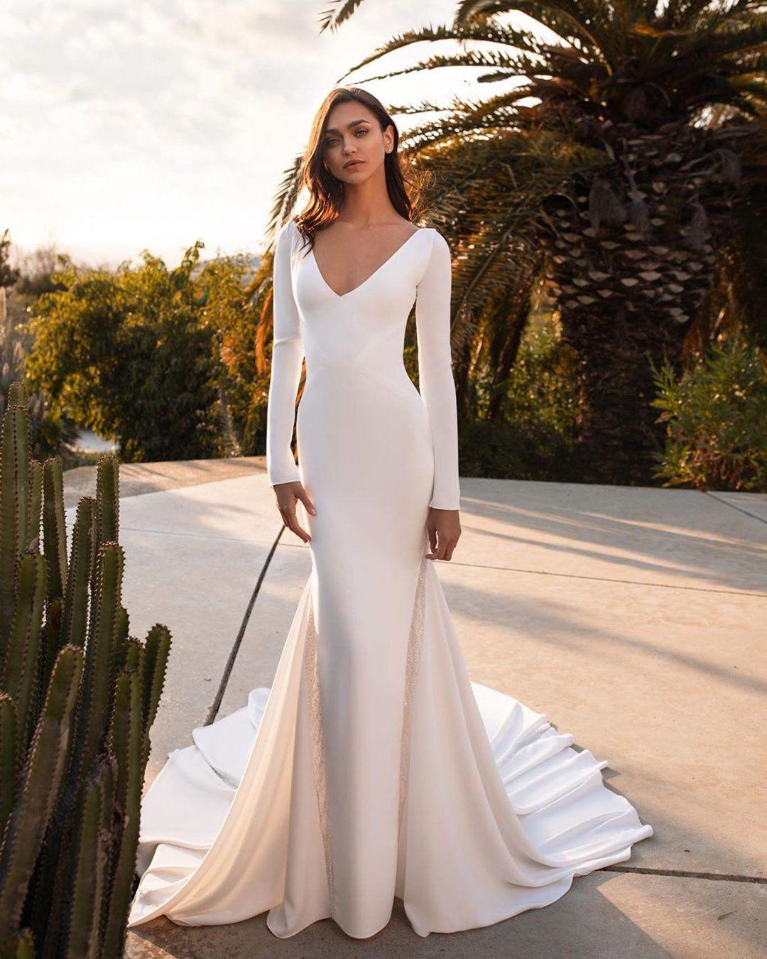 30 Simple Wedding Dresses For Elegant Brides In 2021 Ivory Wedding Dress Wedding Dresses Simple Long Sleeve Mermaid Wedding Dress [ 1350 x 1080 Pixel ]